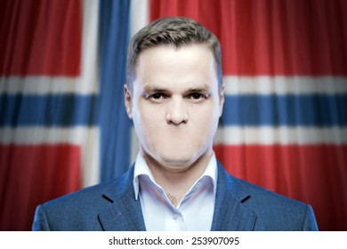 Symbol of censorship and freedom of speech: a young man without a mouth on a background of the national flag of Norway