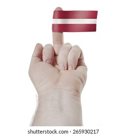 A symbol of challenge: the middle finger with the flag of Latvia