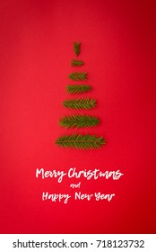 symbol Christmas tree from a fir branches on red background