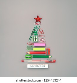 symbol Christmas tree made of stationery, pens, pencils, paper clips, office supplies. new year's concept in office, University, school. Christmas and New Year greeting season. Creative idea design