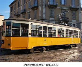A symbol of the city, the old and traditional orange tram in Milan, Lombardy, Italy
