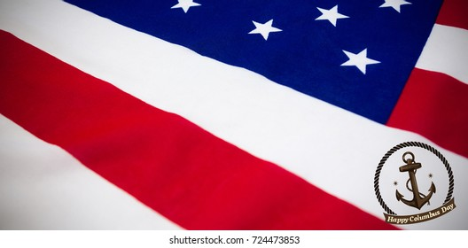 Symbol of colombus day  against high angle view of american flag