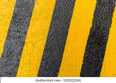 Symbol color of safety road on the non slip yellow and black mark on the floor industrial and factory concept