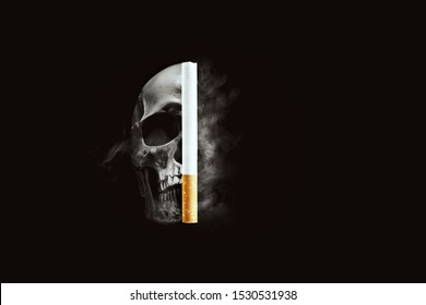 Symbol of the dangers of smoking. Human scull with cigarette and smoke. Copy space.