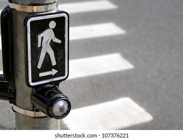a symbol denotes the presence of a crosswalk.