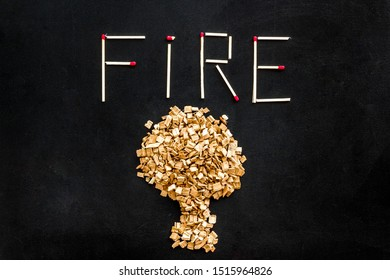 Symbol of fire in woods with tree from kindling and word fire from matches on black background top view