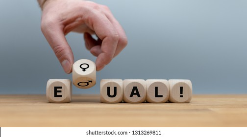 """Symbol for gender equality.. Dice form the word """"EQUAL"""" in front of a grey background. Instead of the letter Q the symbols for women and men are used."""