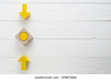 Symbol of goal and objective. Two wooden arrows converge towards the center target, top view. Arrows pointing to the object, flat lay, copy space. Concept of the implementation of the planned success.