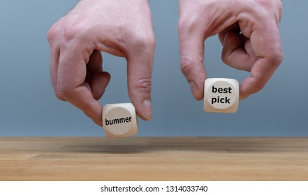 "Symbol for a good decision. Two Hands hold two dice with the words ""bummer"" and ""best pick"". The dice with the label ""best pick"" is chosen."