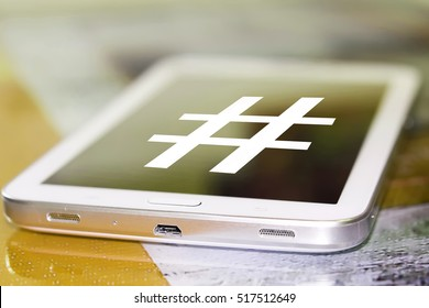 The symbol hashtag on the cell phone screen .