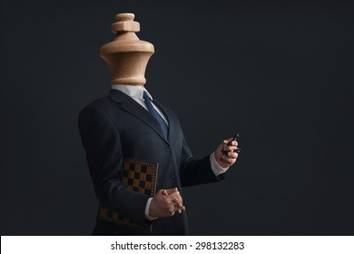 Symbol of a Headless Narcissist with pawns in the hands