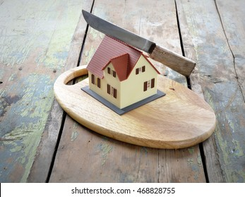Symbol of the house is cut with a knife. The concept of the division of property.