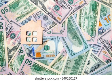The symbol of the house lies on the background of the American currency