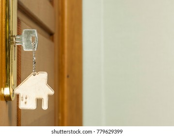 Symbol of the house and stick the key in the keyhole