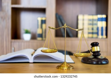 Symbol of Judge law attorney gavel with Justice lawyers table desktop, workplace with documents