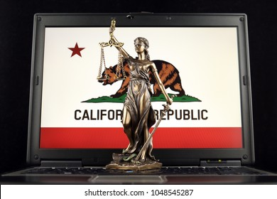 Symbol of law and justice with California State Flag on laptop. Studio shot.