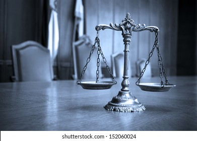 Symbol of law and justice, law and justice concept, focus on the scales, blue tone
