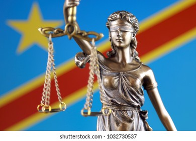 Symbol of law and justice with Democratic Republic of the Congo Flag. Close up.