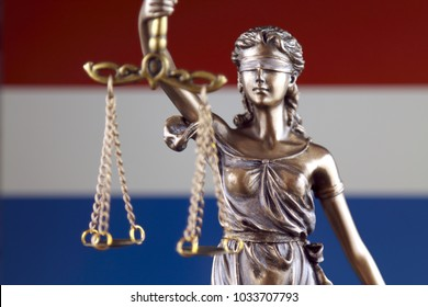 Symbol of law and justice with Netherlands Flag. Close up.