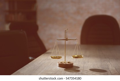 Symbol of law and justice on wooden table in lawyer office