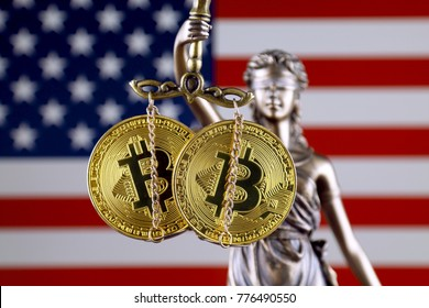 Symbol of law and justice, physical version of Bitcoin and United States Flag. Prohibition of cryptocurrencies, regulations, restrictions or security, protection, privacy.