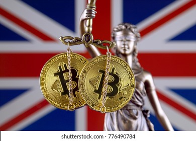 Symbol of law and justice, physical version of Bitcoin and United Kingdom Flag. Prohibition of cryptocurrencies, regulations, restrictions or security, protection, privacy.