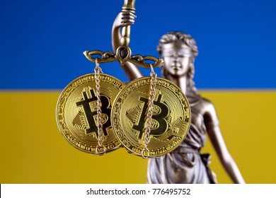 Symbol of law and justice, physical version of Bitcoin and Ukraine Flag. Prohibition of cryptocurrencies, regulations, restrictions or security, protection, privacy.