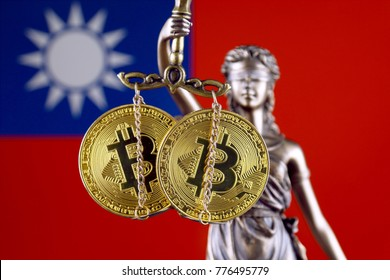 Symbol of law and justice, physical version of Bitcoin and Taiwan Flag. Prohibition of cryptocurrencies, regulations, restrictions or security, protection, privacy.