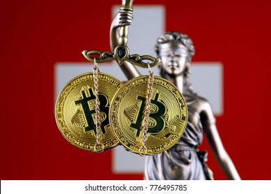Symbol of law and justice, physical version of Bitcoin and Switzerland Flag. Prohibition of cryptocurrencies, regulations, restrictions or security, protection, privacy.