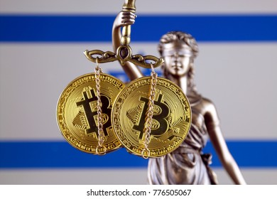 Symbol of law and justice, physical version of Bitcoin and Israel Flag. Prohibition of cryptocurrencies, regulations, restrictions or security, protection, privacy.