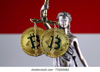 Symbol of law and justice, physical version of Bitcoin and Indonesia Flag. Prohibition of cryptocurrencies, regulations, restrictions or security, protection, privacy.