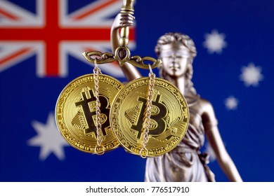 Symbol of law and justice, physical version of Bitcoin and Australia Flag. Prohibition of cryptocurrencies, regulations, restrictions or security, protection, privacy.