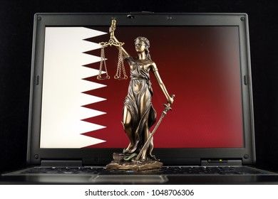 Symbol of law and justice with Qatar Flag on laptop. Studio shot.