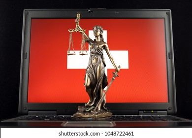 Symbol of law and justice with Switzerland Flag on laptop. Studio shot.