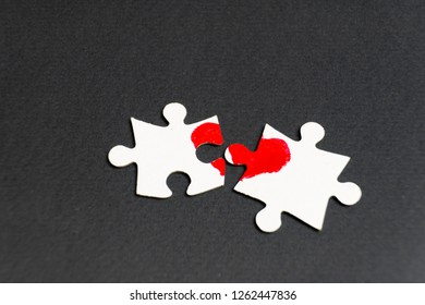 Symbol of love. Heart drawn on two puzzles.