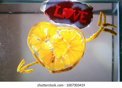 Symbol of love made by orange pieces and paper