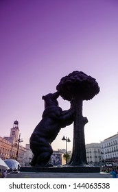Symbol of Madrid - statue of Bear and strawberry tree situated on the Puerta del Sol with deep purple sky on the background