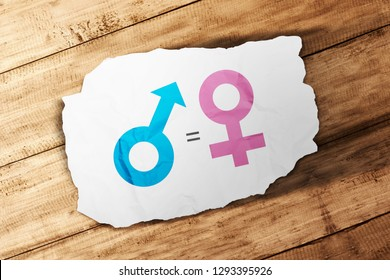 Symbol of male gender is equal to female in white paper on wooden table. Equality gender concept