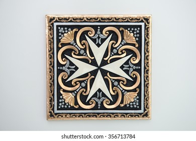 Symbol of the maltese Knights  decorated on a square tile ./ Knights of malta Symbol