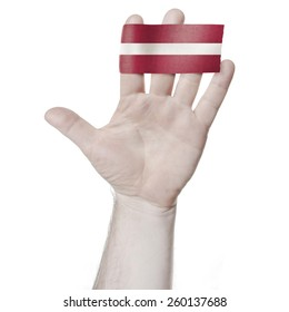 Symbol of national honor: the open palm of the hand with the flag of Latvia