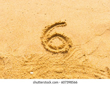 symbol number 6 sand handmade on beach