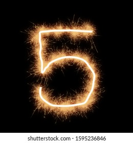 Symbol of number five written by squib sparks on a black background.