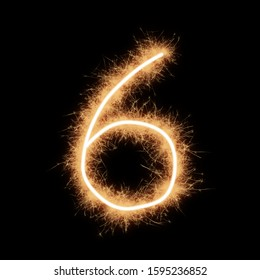 Symbol of number six written by squib sparks on a black background.