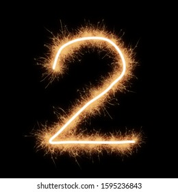 Symbol of number two written by squib sparks on a black background.