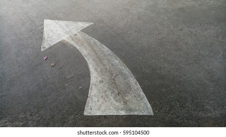 Symbol on the street.An arrow on the road.sign on street.