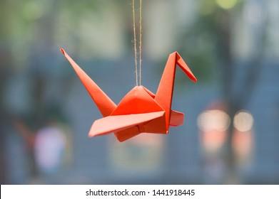 Symbol of peace, faith, paper crane. Origami, red