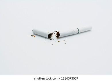 A symbol of quitting smoking. A broken cigarette on an isolated white background.