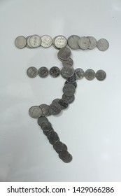 Symbol of rupee with indian coins on white Background