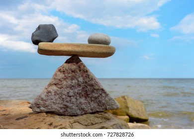 Symbol of scales of the stones on the seashore