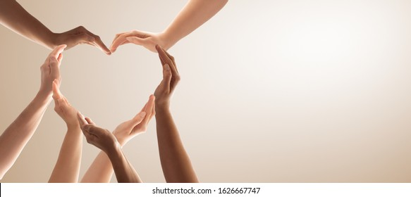 Symbol and shape of heart created from hands.The concept of unity, cooperation, partnership, teamwork and charity. - Shutterstock ID 1626667747